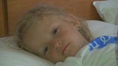 Little Girl Lying in Bed after a Nap, Sleepy Child Looking at Camera Stock Footage