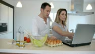 Stock Video Footage of couple in kitchen checking recipe