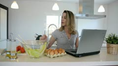 Woman checking recipe on internet Stock Footage