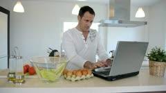 man checking recipe on internet - stock footage