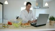Stock Video Footage of man checking recipe on internet