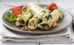 Cannelloni filled with spinach, roquefort and walnuts Stock Photos