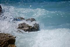 splash on the rocks - stock photo