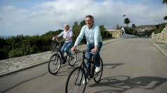 Senior couple riding bicycle Stock Footage