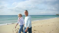 senior couple walking by the beach - stock footage