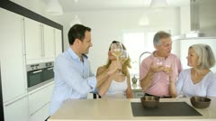 family in home kitchen drinking wine - stock footage
