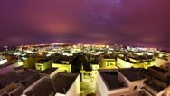 Timelapse of clouds passing by over night city, 4K Stock Footage
