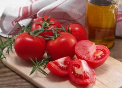 tomatoes, spices and olive oil for cooking healthy food - stock photo