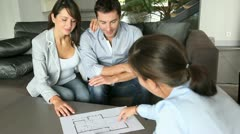 couple signing for the purchase of their future home - stock footage