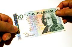 paying with a banknote - stock photo