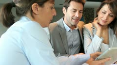 Couple meeting architect for plans of future home Stock Footage