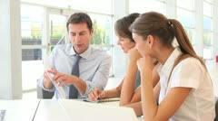 manager presenting business plan to employees - stock footage