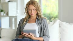 Woman buying online with electronic tablet Stock Footage