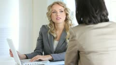 Real-estate agent with client in office Stock Footage