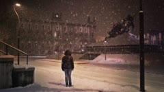 Girl under snow in Europe - stock footage