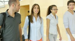 Group of college students walking in hall Stock Footage