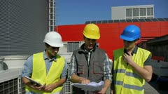 construction foreman training young people on site - stock footage