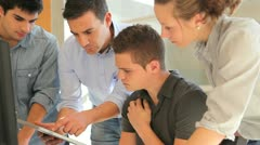 group of students with teacher working on electronic tablet - stock footage