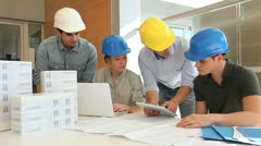 educator with students in architecture working on electronic tablet - stock footage