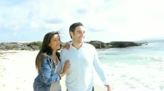 in love couple walking by the beach - stock footage