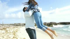 man lifting his girlfriend up and turning around - stock footage