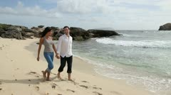 Happy couple walking by the beach Stock Footage