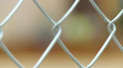 RACK FOCUS FENCE TO CONSTRUCTION WORKERS Stock Footage