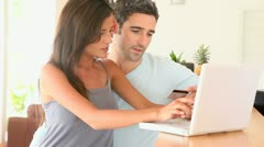 Couple at home purchasing on internet Stock Footage