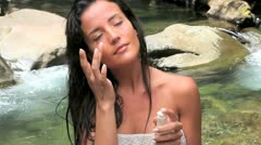 Beautiful woman applying moisturizer Stock Footage