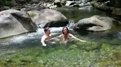 couple bathing in river water - stock footage