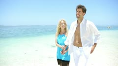 Couple walking in blue lagoon water Stock Footage