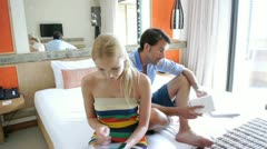 couple in hotel room weburfing on internet - stock footage