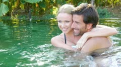 Couple swimming in natural water pool Stock Footage