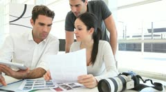 Work meeting in photo agency Stock Footage