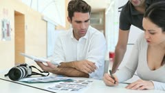 Work meeting in photo agency Stock Footage