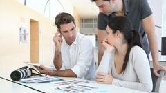 work meeting in photo agency - stock footage