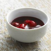 Cherry compote in a ceramic bowl Stock Photos