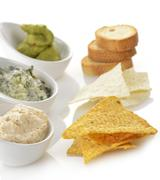 Dips with chips and toasts Stock Photos