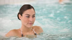 Young woman in spa relaxing in jacuzzi water Stock Footage