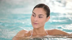 Stock Video Footage of young woman in spa relaxing in jacuzzi water