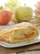 Slice of an apple strudel Stock Photos