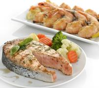 slice of salmon and shrimps - stock photo