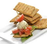 crackers with mozzarella and tomatoes - stock photo