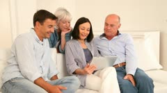 Parents and grandparents using electronic tablet Stock Footage