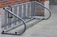 empty bicycle rack with lock - stock photo