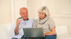 Senior couple paying online with credit card Stock Footage