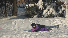 Mother and Child Playing in Snow, Trundling through Snow, Winter Season Stock Footage