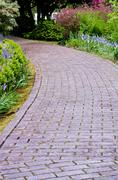 garden path with flowers blooming - stock photo