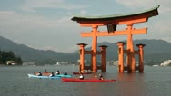 Stock Video Footage of Canoes at the floating torii gate on Miyajima island, Japan
