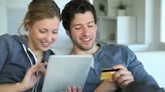 young couple at home buying on internet - stock footage